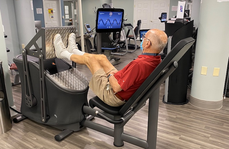 Older man working out on EGYM Smart Strength machine