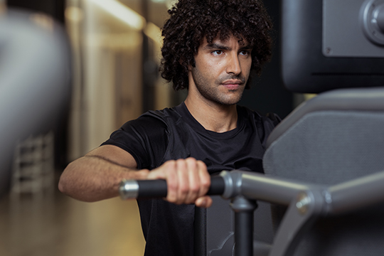 Young man on Smart Strength machine