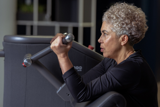 Older woman on Smart Strength machine